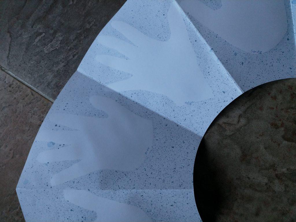 using masks to create splatter marks for handprints on toroidal book